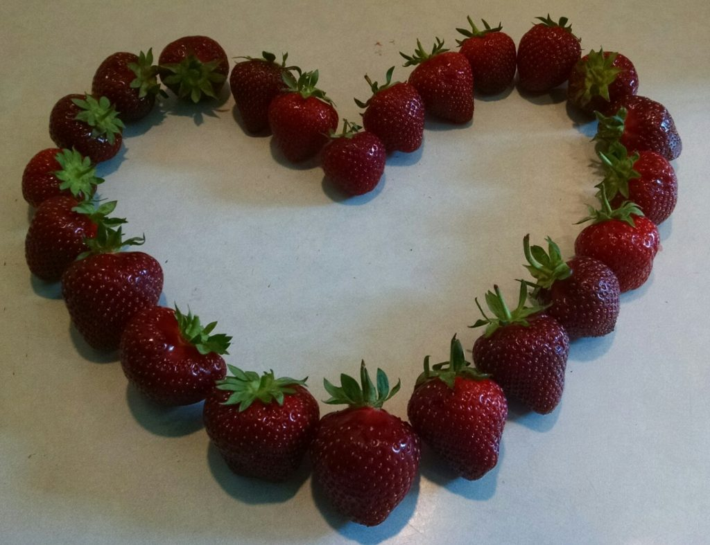 A heart shaped from strawberries