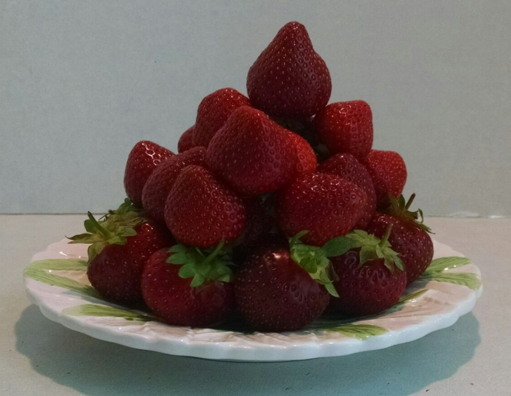 a pyramid made from strawberries