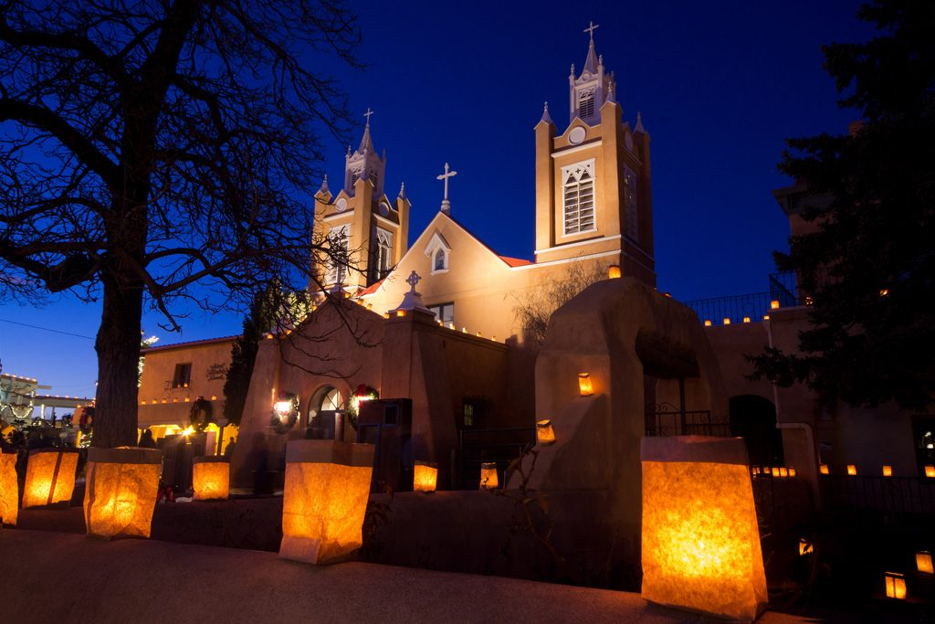 church decorated with luminarias