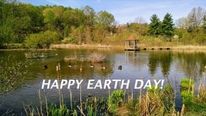 pond with sign saying Happy Earth Day!