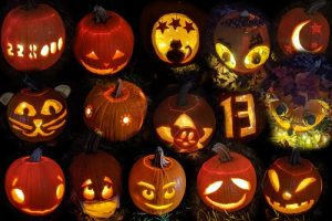 collage of carved pumpkins in the dark