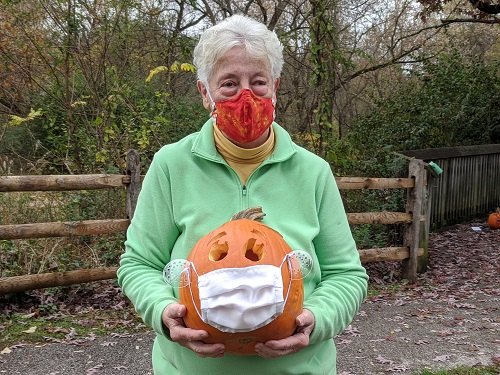 lady holding a carved pumpkin