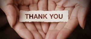 open hands with thank you note